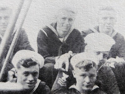 After a stint working in the ship's butcher shop, Bassett (center) took his place as a signalman, sending and receiving messages from other ships. COURTESY PHOTO