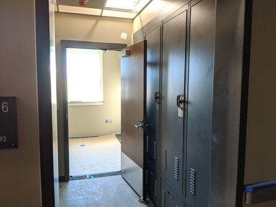 Each bunk room has a small anteroom with lockers, eliminating the need for dedicated locker rooms.