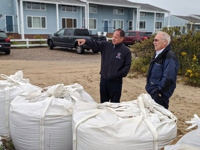 Deputy Fire Chief David DePasquale (left) and Chief Peter Connick watch the rising water at the end of Starfish Lane during a recent coastal storm. ALAN POLLOCK PHOTO
