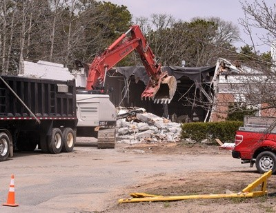 The demolition is bittersweet for many Harwich firefighters, some of whom—like Chief Norman Clarke, Jr.—started their firefighting careers there.