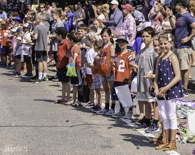 Kids along the parade route eagerly await more candy.  KAT SZMIT PHOTO