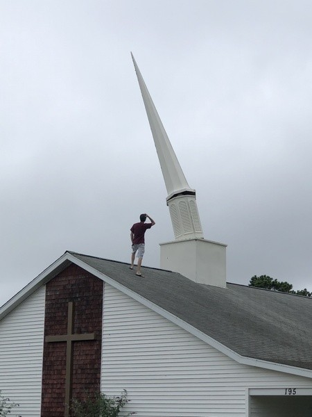 Rev. Mike Pratt surveys the damage to the spire at the Redemption Rock Church on Meetinghouse Road in South Chatham. COURTESY PHOTO